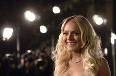 """<p>Actress Lindsay Lohan poses for photographers at the premiere of the film """"Cloverfield"""" in Los Angeles January 16, 2008. REUTERS/Phil McCarten</p>"""