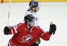 <p>Canada's Eric Staal (front) celebrates his first period goal as Germany's Sebastian Osterloh skates away during their game at the 2008 IIHF World Hockey Championships in Halifax, May 10, 2008. REUTERS/Paul Darrow</p>