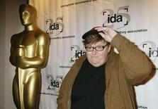 "<p>Michael Moore, director and producer of the film ""Sicko"" which is nominated for an Oscar as Best Documentary Feature, poses at the International Documentary Association's annual celebration of the Academy Awards Documentary nominees in Beverly Hills, California February 20, 2008. REUTERS/Fred Prouser</p>"
