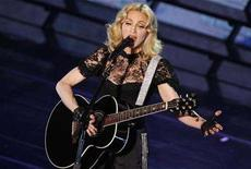 """<p>Singer Madonna performs during a concert to celebrate the launch of her new album """"Hard Candy"""" in Paris May 6, 2008. REUTERS/Benoit Tessier</p>"""