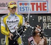 <p>Il ciclista russo Pavel Brutt della squadra Tinkoff celebra oggi la vittoria della quinta tappa del Giro d'Italia. REUTERS/Giampiero Sposito (ITALY)</p>