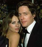 <p>File photo shows Actress and model Elizabeth Hurley and then boyfriend Hugh Grant posing together at the Paramount and Miramax Studios party following the 57th annual Golden Globe Awards in Beverly Hills January 23, 2000. Grant and Hurley and her new husband won thousands of pounds (dollars) in damages on Thursday after paparazzi pictures taken while they were on holiday were published in tabloid newspapers. 	 REUTERS/Fred Prouser</p>