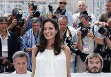 """<p>Voice actors Dustin Hoffman (L), Angelina Jolie (C) and Jack Black pose during a photocall for the animated film """"Kung Fu Panda"""" by directors Mark Osborne and John Stevenson at the 61st Cannes Film Festival May 15, 2008. REUTERS/Jean-Paul Pelissier</p>"""