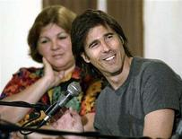 <p>Brazilian director Walter Salles (R) speaks to the media during a press conference in Havana, June 14, 2004. REUTERS/Rafael Perez</p>