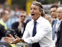 <p>L'allenatore dell'Inter, Roberto Mancini, durante la partita di domenica scorsa dei nerazzurri contro il Siena. REUTERS/Stefano Rellandini (ITALY)</p>