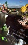 <p>Fresh flowers lay by the grave of Irish Republican hunger striker Bobby Sands who died in 1981 in the Miltown Cemetary of the Falls Road in Belfast October 27, 2001. REUTERS/Jeff J Mitchell</p>