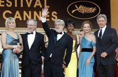 """<p>Director Steven Spielberg (2nd L), his wife Kate Capshaw (L), producer George Lucas (C), Melody Hobson (3rd R), Calista Flockhart (2nd R) and Harrison Ford (R) wave to the public before the world premiere screening of the film """"Indiana Jones and the Kingdom of the Crystal Skull"""" at the 61st Cannes Film Festival May 18, 2008. REUTERS/Vincent Kessler</p>"""