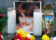 <p>Former Beatle George Harrison is remembered by fans at the Beatles star on Hollywood Boulevard's walk of fame in Los Angeles, November 30, 2001. REUTERS/Mike Blake</p>