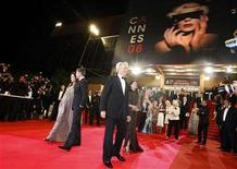 """<p>U.S. director Clint Eastwood (C) walks with his wife Dina as cast member Angelina Jolie (L) and actor Brad Pitt walk on the red carpet after the screening of """"The Exchange"""" at the 61st Cannes Film Festival May 20, 2008. REUTERS/Eric Gaillard</p>"""