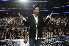 "<p>Finalist David Cook stands onstage at the Nokia Theatre after winning the finale of ""American Idol"" in Los Angeles May 21, 2008. REUTERS/Mario Anzuoni</p>"
