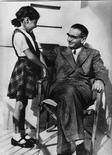<p>Rezso Kasztner is pictured with his daughter Zsuzsi in Tel Aviv in this 1957 photograph. Two new books about Kasztner have been published and a documentary film is being prepared for distribution later this year. All paint him as a hidden hero of the Holocaust, a man who risked his life in countless bargaining sessions with the Nazis. REUTERS/Bloomsbury Publishing/Handout S.</p>