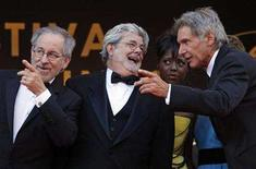 """<p>Steven Spielberg (L), producer George Lucas (C), Melody Hobson (2nd R) and Harrison Ford speak before the world premiere screening of the film """"Indiana Jones and the Kingdom of the Crystal Skull"""" at the 61st Cannes Film Festival May 18, 2008. REUTERS/Jean-Paul Pelissier</p>"""