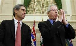<p>Liberal leader Stephane Dion (R) speaks at the start of a caucus meeting with deputy leader Michael Ignatieff on Parliament Hill in Ottawa April 2, 2008. REUTERS/Chris Wattie</p>