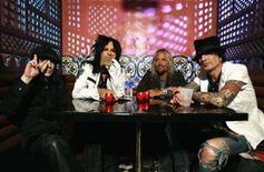 "<p>(L-R) Motley Crue's Mick Mars, Nikki Sixx, Vince Neil and Tommy Lee pose at Avalon in Hollywood, April 15, 2008. Last month, Motley Crue decided to find out. The band placed its new single, the title track from ""Saints of Los Angeles,"" for sale as a downloadable track on ""Rock Band"" well in advance of the album's release date, which has been pushed back to June 24. The only other place to obtain the track was iTunes. REUTERS/Mario Anzuoni</p>"