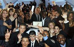 "<p>French director Laurent Cantet (C) is surrounded by students during a photocall after he received the Palme d'Or award for the film ""Entre les Murs (The Class)"" at the 61st Cannes Film Festival May 25, 2008. REUTERS/Jean-Paul Pelissier</p>"