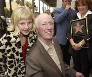 "<p>Comedian Dick Martin (C) poses with Katherine Rowan, the granddaughter of his late comic partner Dan Rowan, after the comedy team were honored with the 2,194th star on the Hollywood Walk of Fame during an unveiling ceremony in Los Angeles April 2, 2002. Martin, who starred with Rowan in the hit 1960s television variety show ""Rowan and Martin's Laugh-In,"" helping to launch the Hollywood careers of stars such as Goldie Hawn and Lily Tomlin, has died. He was 86. REUTERS/Jim Ruymen</p>"