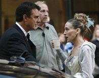 """<p>Sarah Jessica Parker and Chris Noth wait to film a scene on the set of """"Sex and the City:The Movie"""" in New York, October 12, 2007. Do Carrie and Mr. Big marry or don't they? That is the question """"Sex and the City"""" fans hope is answered when the long-awaited film about love and friendship in New York City hits theaters worldwide this week. REUTERS/Brendan McDermid</p>"""