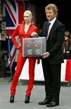 <p>British author Sebastian Faulks poses with a model, as he holds a case containing the first seven copies of his new James Bond book, entitled 'Devil May Care' during its launch in London May 27, 2008. REUTERS/Alessia Pierdomenico</p>
