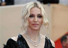 <p>Madonna arrives on the red carpet at the 61st Cannes Film Festival May 21, 2008. REUTERS/Eric Gaillard</p>