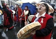 <p>Native women chant during a march in the rundown lower eastside in Vancouver, British Columbia in this February 14, 2007 file photo. REUTERS/Andy Clark/Files</p>