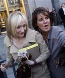 <p>J.K. Rowling, author of the Harry Potter book series, leaves the U.S. District Court in New York, April 15, 2008. The secret of what happened before boy wizard Harry Potter went to Hogwarts will be revealed through the unusual channel of a charity auction next month. REUTERS/Joshua Lott</p>