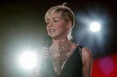 """<p>Actress Sharon Stone delivers her speech at the 16th Life Ball in Vienna May 16, 2008. Luxury retailer Christian Dior has pulled advertisements featuring Stone from stores across China after the actress suggested the country's earthquake was """"bad karma"""" for Beijing's policies in Tibet. REUTERS/Herbert Neubauer</p>"""