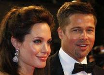 """<p>Cast member Angelina Jolie (L) and actor Brad Pitt leave after the screening of """"The Exchange"""" by U.S. director Clint Eastwood at the 61st Cannes Film Festival May 20, 2008. Jolie has given birth in France to twins fathered by Pitt, bringing the Hollywood couple's brood to six children, according to the celebrity television program """"Entertainment Tonight."""" REUTERS/Vincent Kessler</p>"""