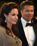 """<p>Angelina Jolie e Brad Pitt dopo la presentazione di """"The Exchange"""" di Clint Eastwood al Festival di Cannes. REUTERS/Vincent Kessler (Francia)</p>"""