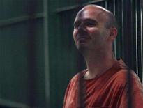 <p>Canadian Christopher Paul Neil sits inside a detention cell at the Bangkok Criminal Court June 2, 2008. REUTERS/Kerek Wongsa</p>