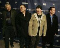 """<p>Members of the band U2 (L-R) Adam Clayton, Bono, The Edge and Larry Mullen pose for photographers as they arrive for the premiere of """"U2 3D"""" the first digital 3D concert film by directors Catherine Owens and Mark Pellington at the 2008 Sundance Film Festival in Park City, Utah January 18, 2008. REUTERS/Fred Prouser</p>"""