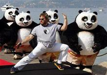 """<p>Jack Black poses near life-sized pandas during a beach photo call for the animated film """"Kung Fu Panda"""" as the 61st Cannes Film Festival starts May 14, 2008. REUTERS/Jean-Paul Pelissier</p>"""