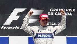 <p>O pilto de F1 Robert Kubica, da BMW Sauber, comemora vitória no GP do Canadá, em Montreal. O vencedor do Grande Prêmio do Canadá de Fórmula 1, Robert Kubica, disse no domingo, depois da corrida, que tem todas as chances de sagrar-se campeão da categoria neste ano. Photo by Jim Young</p>