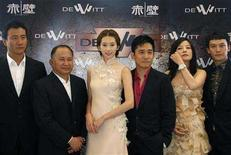 """<p>John Woo (2nd L) poses with cast members (from L-R) Hu Jun, Lin Chi-ling, Tony Leung, Zhao Wei and Chang Chen during a photocall for the film """"Red Cliff"""" at the 61st Cannes FIlm Festival May 19, 2008. REUTERS/Christian Hartmann</p>"""