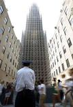 <p>People walk past artist Chris Burden's 65-foot tall skyscraper sculpture, constructed out of toy parts, in the plaza at Rockefeller Center, in New York, June 10, 2008. REUTERS/Chip East</p>