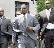 <p>Recording artist R Kelly (C) walks out of Cook County Court after closing arguments in his trial in Chicago, Illinois June 12, 2008. REUTERS/Frank Polich</p>