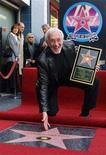 <p>Special effects creator Stan Winston displays his star on the Hollywood Walk of Fame in this February 23, 2001 file photograph. The Stan Winston Studio told the Los Angeles Times on June 16, 2008 that Winston, 62, an Oscar-winning visual effects artist died at his Los Angeles home on June 15, 2008 after a seven-year struggle with multiple myeloma. REUTERS/Frederick Brown/Files</p>