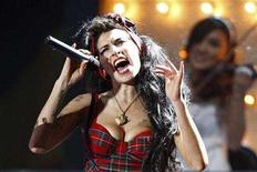 <p>Amy Winehouse performs at the Brit Awards at Earls Court in London, February 20, 2008. Winehouse remained in hospital on Tuesday for more tests after fainting at home on Monday and being rushed to a clinic by her father, a spokesman said. REUTERS/Alessia Pierdomenico</p>
