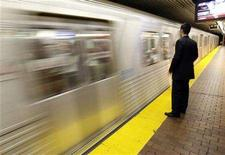 <p>A transit rider waits for a subway car to stop on a platform in Union Station, Toronto's main commuter hub, in downtown Toronto, May 10, 2006. REUTERS/J.P. Moczulski</p>