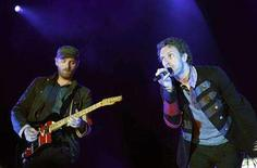 "<p>Chris Martin (R) and Jonny Buckland of British band Coldplay perform during a concert, part of the ""Viva la vida"" tour, in Barcelona June 17, 2008. REUTERS/Albert Gea</p>"