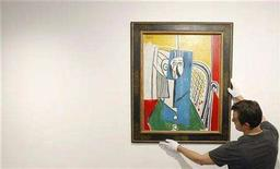 "<p>Display coordinator Benjamin Sheppard hangs the 1954 painting by Pablo Picasso titled ""Sylvette"" at an auction house in Sydney June 18, 2008. REUTERS/Tim Wimborne</p>"
