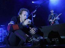 "<p>Chris Martin of British band Coldplay performs during a concert, part of the ""Viva la vida"" tour, in Barcelona June 17, 2008. REUTERS/Albert Gea</p>"