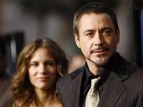 """<p>Cast member Robert Downey Jr. and his wife Susan Downey attend the premiere of """"Iron Man"""" at the Grauman Chinese Theatre in Hollywood, California April 30, 2008. REUTERS/Mario Anzuoni</p>"""
