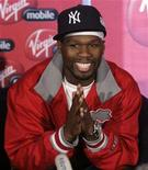 <p>Rapper 50 Cent from the U.S. reacts during a media briefing at Lanseria airport outside Johannesburg April 30, 2008. REUTERS/Siphiwe Sibeko</p>