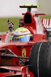 <p>Il ferrarista Felipe Massa esulta all'arrivo del Gran Premio di Francia. REUTERS/Benoit Tessier (FRANCE)</p>
