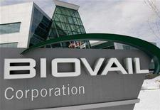 <p>The U.S. and Canadian flags fly in front of the futuristic looking Biovail Corporation Head Office in Mississauaga, a Toronto suburb, March 4, 2005. Biovail Corp's shareholders will know later this week whether they have plotted a course that could dramatically change the future of Canada's biggest publicly traded drugmaker. REUTERS/J.P. Moczulski JPM</p>