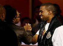 "<p>Kanye West (R) accepts the award for best collaboration for ""Good Life "" with T-Pain at the 2008 BET Awards in Los Angeles June 24, 2008. REUTERS/Mario Anzuoni</p>"