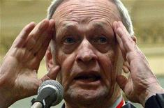 <p>Former Canadian Prime Minister Jean Chretien speaks with journalists after being awarded the rank of Companion in the Order of Canada at Rideau Hall in Ottawa February 22, 2008. A federal judge has delivered a scathing rebuke of the report of a 2005 official inquiry that said Chretien was partly responsible for a kickbacks scandal that helped knock the Liberal government from power. REUTERS/Chris Wattie</p>