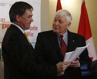 """<p>Lynton """"Red"""" Wilson (R), chair of the Competition Policy Review Panel, delivers the panel's report to Canada's Industry Minister Jim Prentice during an event on Parliament Hill in Ottawa June 26, 2008. REUTERS/Chris Wattie</p>"""