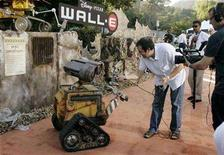 "<p>An animatronic robot of character Wall-E is interviewed by a TV crew at the world premiere of Disney-Pixar's film ""Wall-E"" in Los Angeles, California June 21, 2008. REUTERS/Fred Prouser</p>"