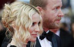 <p>Singer Madonna (L) and director Guy Ritchie arrive on the red carpet at the 61st Cannes Film Festival, May 21, 2008. REUTERS/Vincent Kessler</p>